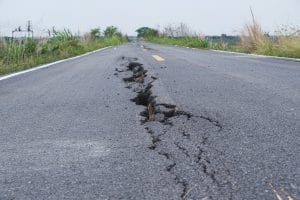 How Do Road Design and Road Defects Lead to Truck Accidents?